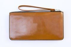 在白色背景的特写镜头棕色皮革钱包 免版税图库摄影