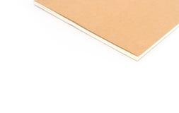 在白色背景的特写镜头棕色笔记本颜色 免版税库存图片