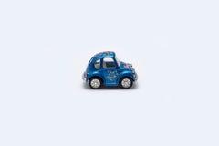 在白色背景的玩具汽车 库存图片