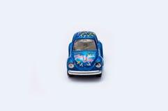 在白色背景的玩具汽车 免版税库存照片