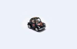 在白色背景的玩具汽车 免版税图库摄影