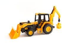 玩具黄色拖拉机 库存图片