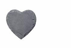 在白色背景的石心脏 免版税库存图片