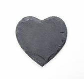 在白色背景的石心脏 免版税库存照片