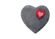在白色背景的石心脏 图库摄影