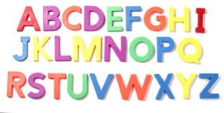 在白色背景的磁性字母表信件 免版税图库摄影