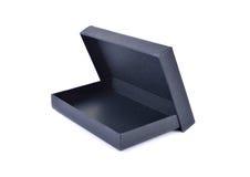 在白色背景的空的纸黑匣子 库存图片