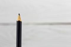 在白色背景的简单的铅笔 图库摄影