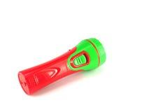 在白色背景的红色和绿色手电 库存图片