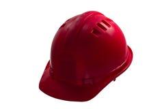 在白色背景的红色安全帽 在丝毫隔绝的安全帽 免版税库存图片