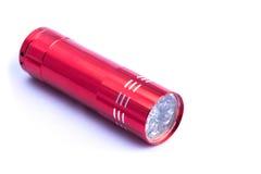 在白色背景的红色手电 免版税库存图片