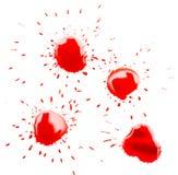 在白色背景的红色斑点污点 免版税库存照片