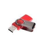 在白色背景的红色USB棍子或闪光驱动 免版税库存图片