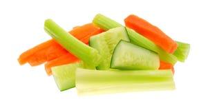在白色背景的红萝卜芹菜和黄瓜 免版税库存照片