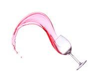 在白色背景的红葡萄酒飞溅。 免版税库存照片