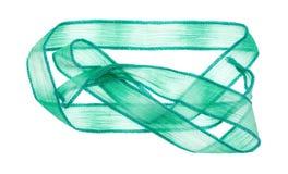在白色背景的纯粹绿色丝带布料材料 库存照片