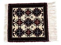在白色背景的美丽的东方土耳其手工制造地毯 图库摄影