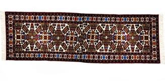 在白色背景的美丽的东方土耳其手工制造地毯 免版税库存照片