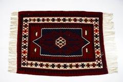 在白色背景的美丽的东方土耳其手工制造地毯 库存图片