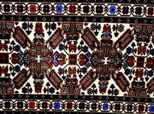 在白色背景的美丽的东方土耳其手工制造地毯 免版税库存图片