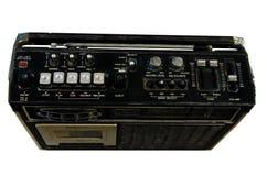 在白色背景的老晶体管收音机。 库存图片