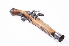 在白色背景的老枪 免版税库存照片