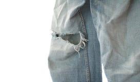 在白色背景的老牛仔裤缺乏 库存图片