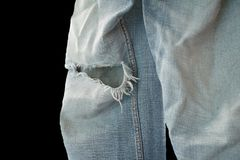 在白色背景的老牛仔裤缺乏 免版税库存图片