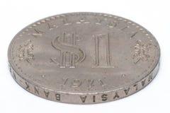 在白色背景的老马来西亚硬币 库存照片