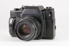 在白色背景的老SLR照相机 免版税库存照片