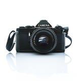 在白色背景的老SLR黑色照相机 免版税库存照片