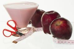苹果计算机和酸奶 免版税图库摄影
