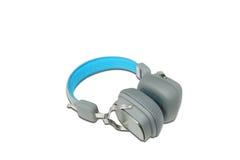 在白色背景的蓝色和灰色耳机,被隔绝 免版税图库摄影