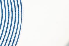 在白色背景的蓝色条纹 图库摄影