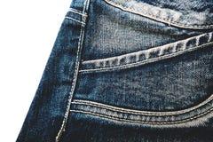 在白色背景的蓝色牛仔布裙子 免版税库存图片