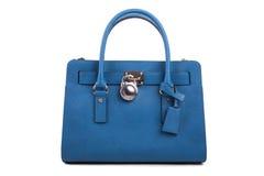 在白色背景的蓝色皮革妇女的提包 免版税库存照片