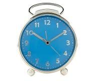 在白色背景的蓝色闹钟 免版税库存照片