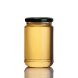 在白色背景的蜂蜜瓶子 免版税库存照片