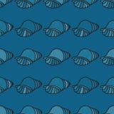 在白色背景的螺旋海壳 库存图片
