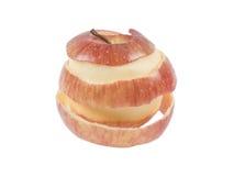 在白色背景的被剥皮的苹果 图库摄影