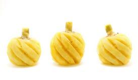 在白色背景的被剥皮的菠萝 免版税库存图片