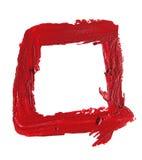 在白色背景的被弄脏的红色唇膏正方形形状 免版税库存图片