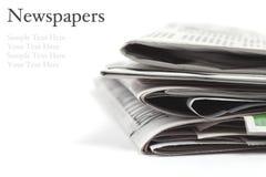 在白色背景的被折叠的报纸 库存图片