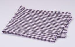 在白色背景的被折叠的餐巾 库存图片