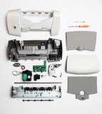 在白色背景的被拆卸的打印机 库存照片