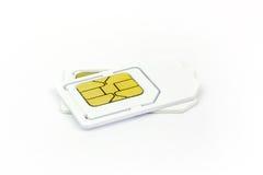 在白色背景的西姆卡片 免版税库存照片