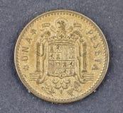 在白色背景的西班牙货币弗朗西斯科・佛朗哥una比塞塔 库存照片
