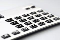 在白色背景的计算器特写镜头 免版税库存照片