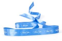 谢意蓝色挥动的丝带  免版税库存图片