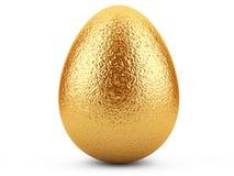 在白色背景的金黄复活节彩蛋。 免版税库存照片
